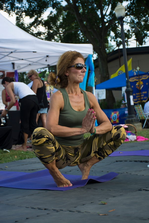 East Northport, NY - At the entrance of John Walsh Park, the Inner Spirit Yoga Center welcomes people to the East Northport Annual Festival with relaxing yoga techniques.