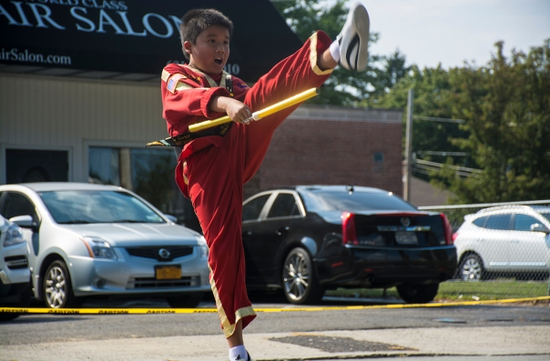 East Northport, NY - A student from Master Chae's Tae Kwon Do in East Northport performs at the East Northport Annual Fair as part of the demo team on September 6th, 2014.