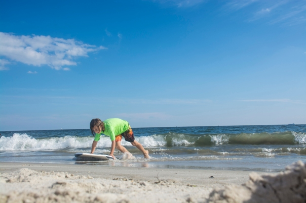 Long Beach, NY - This boy is enjoying the last days of his summer vacation on his boogie board at Long Beach on September 7th, 2014.
